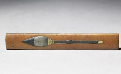 Kozuka, or knife handle, with calligraphy brushfront
