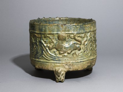Three-legged basin, or lian, with tigers and mountains in reliefoblique