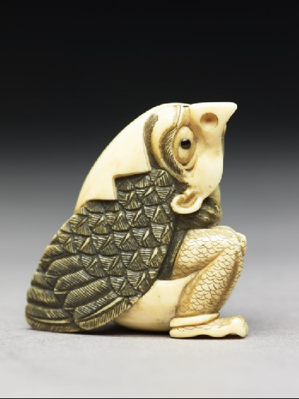 Netsuke in the form of a tengu mountain demon emerging from an eggside