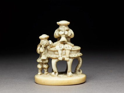 Netsuke in the form of two men playing wind instrumentsfront