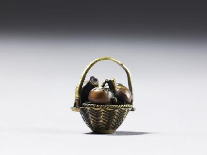 Ojime in the form of a fruit basketside