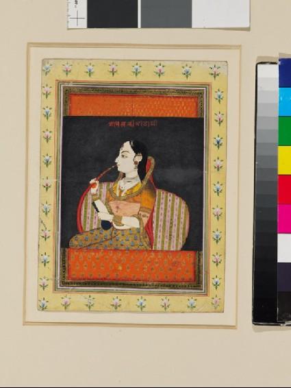 Bust of a woman in a jharoka windowfront