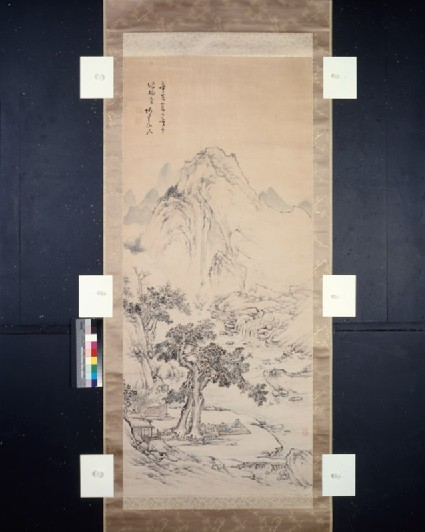 Mountain landscape with figures by a riverfront