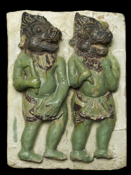Plaque with demon-headed warriorsfront
