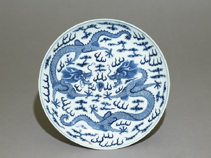 Blue-and-white dish with dragons chasing a flaming pearltop