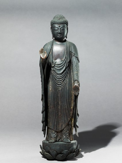 Standing figure of the Buddhaside