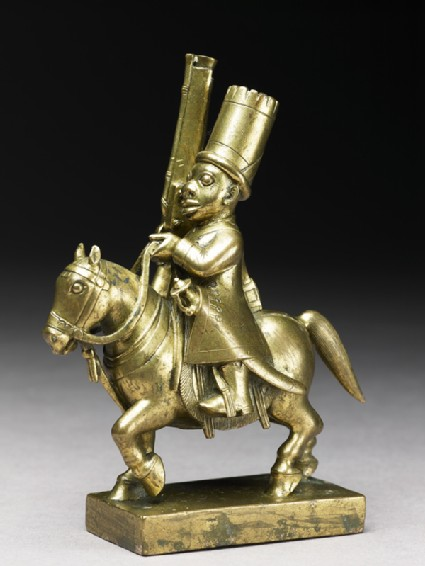 Toy soldier with horse and musketside
