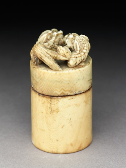 Ivory seal and box surmounted by two lions and with the legend