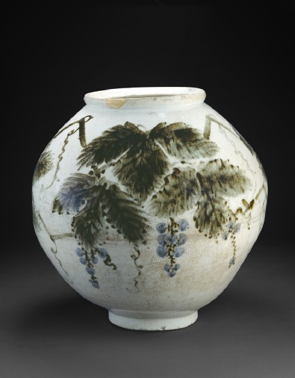 Vase with grape vineside