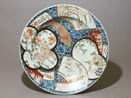 Dish with a shishi, or lion dog, amid animals and flowerstop