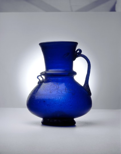 Blue glass jug with naskhi inscriptionside