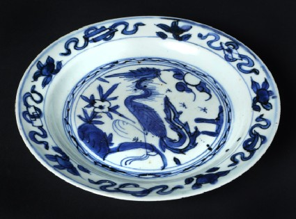 Blue-and-white plate with a cranefront