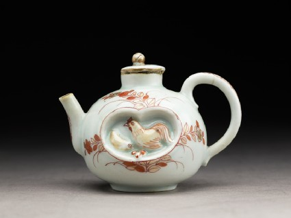 Small teapot with chickens and plantsside