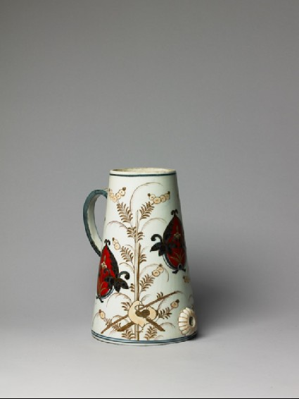 Coffee pot with floral spraysside