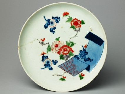 Plate with an open scroll and flowerstop