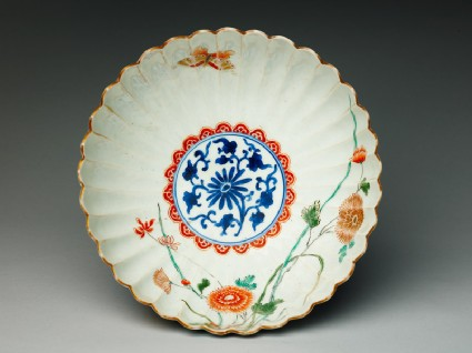 Fluted bowl with daisy, chrysanthemums, and orchidstop