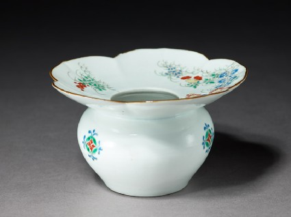 Spittoon with flowering plants and butterfliesoblique