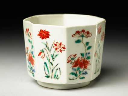 Octagonal cup with peony sprays and flowering plantsoblique