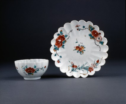 Fluted cup and saucer with floral decorationgroup