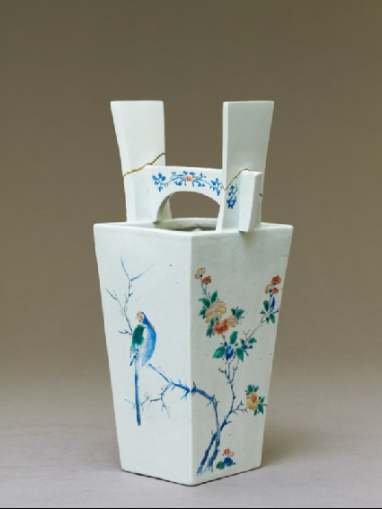 Vase with camellia tree and two birdsoblique