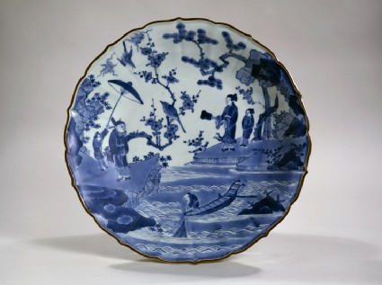 Foliated dish with figures in a landscapetop