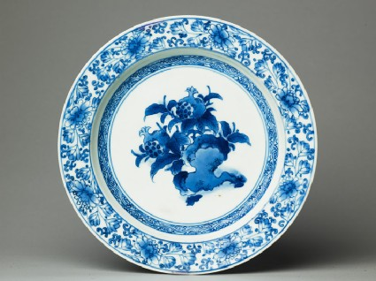 Plate with pomegranates on rockstop