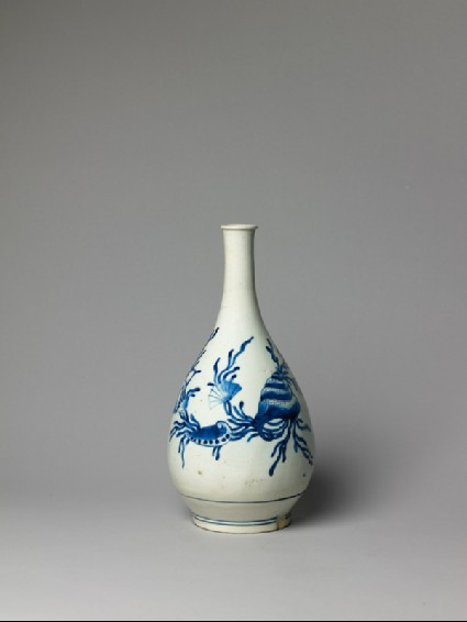 Bottle with seaweed and shell decorationside