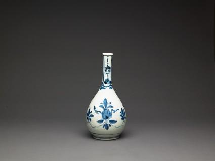 Bottle with formal lotus flower and leaf spraysside
