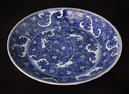Blue-and-white dish with horses amid wavesfront