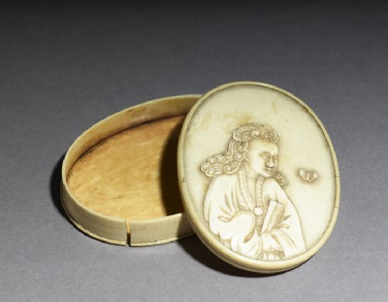 Ivory box with figure holding a fanoblique, open