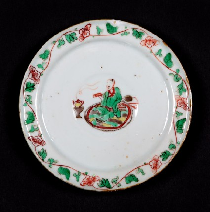 Dish with seated figure reading a bookfront