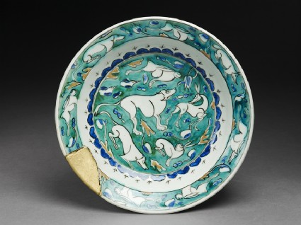 Dish with hares, hounds, and a stagtop