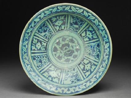 Dish with floral decoration in radial panelstop
