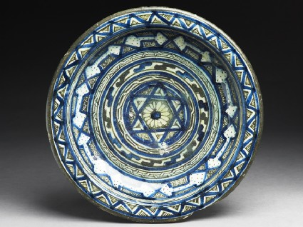 Dish with central six-pointed star and concentric bands of geometric decorationtop