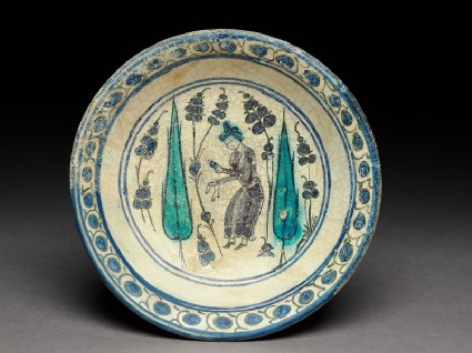 Saucer with turbaned figure between two cypress treestop