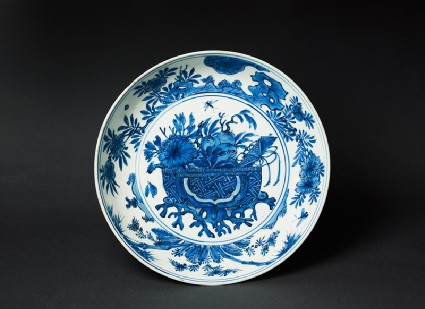 Blue-and-white dish with basket of flowerstop