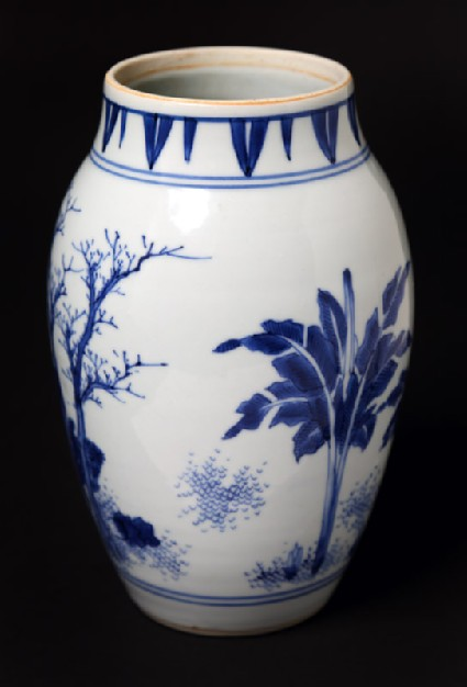 Blue-and-white jar with mythical figures in a landscapefront