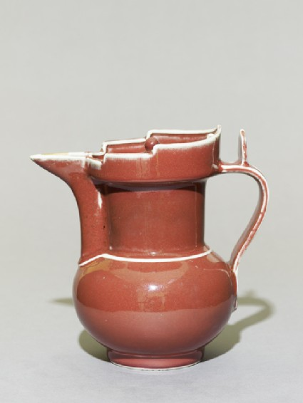 Porcelain ewer in the form of a Tibetan monk's capside