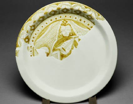 Fragmentary dish with figure of a musicianfront