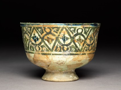 Stem bowl with geometric frieze and pseudo-kufic inscriptionside
