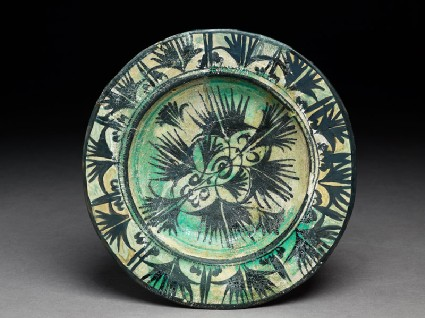 Dish with papyrus plants and leavestop