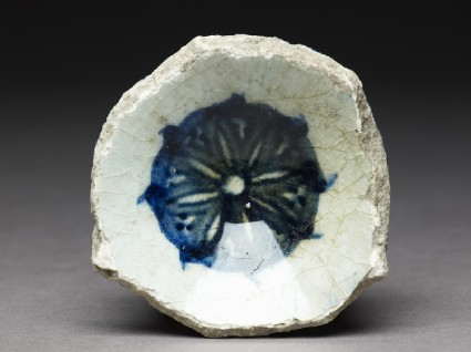 Base fragment of a bowl with blue rosettefront