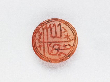 Circular bezel seal with inscription in cursive script and star decorationfront