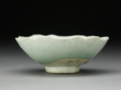 White ware cup with foliated rimside