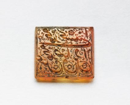 Rectangular bezel seal with nasta'liq inscription and floral decorationfront