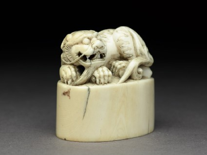Private ivory seal surmounted by a shishi, or lion dogoblique