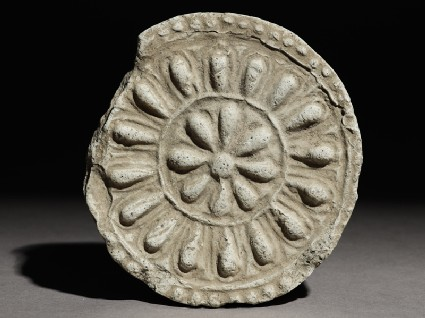 Circular roof end-tile with floral decorationfront