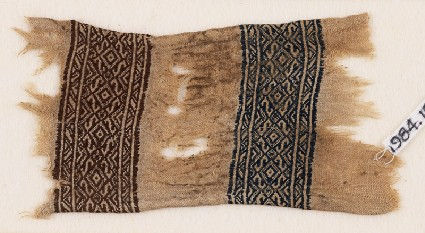 Textile fragment with bands of triangles, S-shapes, and diamond-shapesfront