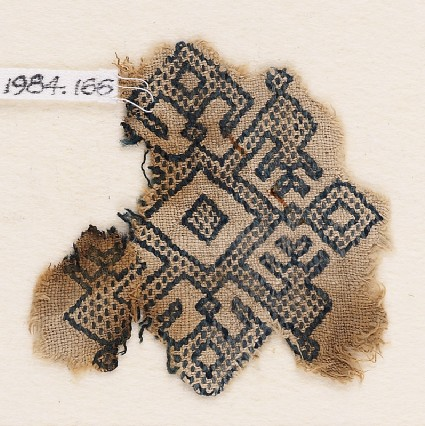 Textile fragment with diamond-shapes, inverted hooks, and arrowheadsfront