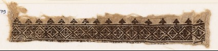 Textile fragment with diamond-shapes and floral quatrefoils, probably from a garmentfront